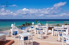 The trendy Sky Bar at Secrets Aura Cozumel is a cozy escape in paradise with gorgeous views of the sea.