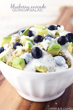 A tasty quinoa salad with fresh blueberries and avocados, crumbled feta, and a lightened up creamy poppyseed dressing!