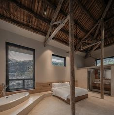 The Shanghai-based Ares Partners converted a cluster of 1950s granary buildings into a calm modern compound of white oblong volumes lined with deeply set eaves, low stone walls, and capped with classic Chinese clay roofs. Inside, old false ceilings were removed to reveal soaring timber roof rafters, whilst existing windows in the minimalist bedrooms have been widened to impressively frame the mountain-scape. Chinese Architecture, Architecture Office, Contemporary Architecture, Architecture Design, Interior Lighting, Lighting Design, Timber Roof, Landscape And Urbanism, Stone Facade