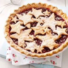 A homemade cherry filling peeks out from a star-shaped pastry top. You can try different shapes for other occasions and also add almond extract for another flavor. | Country Fair Cherry Pie Recipe from Taste of Home