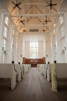 A simple church ceremony with orchid garlands | Brides.com