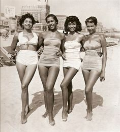 52 Photos Of Classic Cool That Will Make You Wish We Dressed Like We Used To - Four women on the beach in the 1950s.