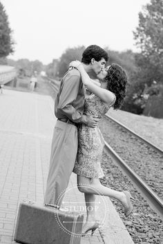 Travel/railroad themed engagement session. photo by studiopphoto.com