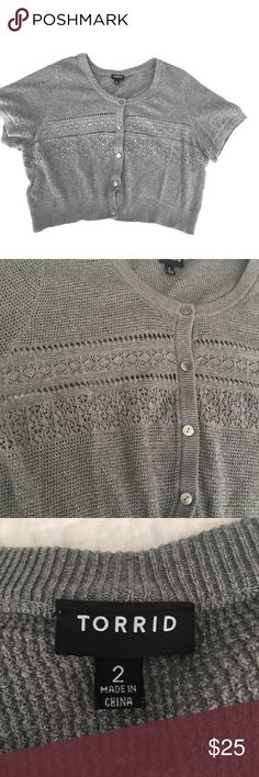 > Torrid < Cropped Gray Cardigan / Shrug Torrid Size 2. This lightweight gray cropped cardigan is the perfect layered addition to sleeveless shirts and dresses. Soft lace-y accents add dimension. Hem is flattering and falls just below bustline. Machine-washable. Like new, worn once. Smoke-free home. torrid Sweaters Cardigans