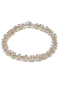 The perfect combination of 925 sterling silver & gold. This Cluster Gold Bracelet will look beautiful as a statement piece
