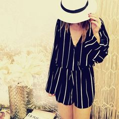 Vision Romper by Faithfull the Brand Striped long sleeve romper. Surplice neckline. Front hook and eye closure. Back tie closure. Elasticized waistband. Material: 100% Rayon Color: Navy/White Faithfull the Brand Pants Jumpsuits & Rompers