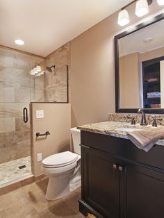 Love the colors and finishes in this basement bath {from Houzz ~ Basement with wine cellar from James Barton Design Build}