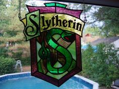 Slytherin from Harry Potter by grandapok.deviantart. Slytherin FTW. The letters are painted on the rear with acrylic. Stained Glass Suncatchers, Faux Stained Glass, Stained Glass Designs, Stained Glass Projects, Stained Glass Patterns, Leaded Glass, Mosaic Art, Mosaic Glass, Disney Stained Glass