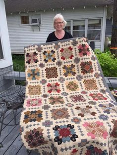 "Quilter Jane Velander displays her quilt ""Lucy Boston Patchwork of the Crosses"""