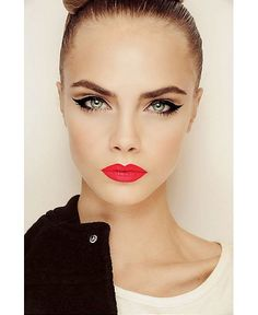 This ballerina is angry. Tight glossed high bun and liquid liner eye flicks. Add some white/ lighter pigment around the eyes and a bold red lip. Those brows...