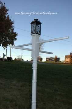 A Light post, Bird Feeder Station, and Hanging Basket Stand all in One!    http://www.growingthehomegarden.com/2012/11/a-light-post-bird-feeder-station-and.html    http://pinterest.com/lowes/