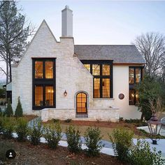 Modern Farmhouse house exterior ideas with white brick. Love the lines of the front roof and how it intersects with the main roof line. Curb appeal ideas, house exterior inspo, white houses with gray roofs Future House, My House, Tudor House, Cottage House, Tudor Cottage, Cottage Style, English Cottage Exterior, English Tudor Homes, Grand House