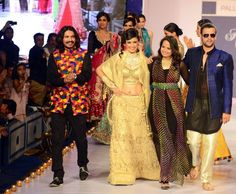Rajasthan Fashion Week 2013, India. Love the black dress with rainbow stripes, second to right...