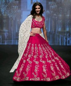Featuring a zari work lehenga choli in pink art silk base. The brocade lace on th bottom gives the complete new touch to the lehenga. It comes along with matching cotton base dupatta finishing the look completely royal!  Code : S781 Title : Pink Elegance Lehenga Choli With Cotton Embroidered Dupatta. Size : Free Color : Pink Fabric : Art silk, Cotton Type : Embroidered Occasion : Wedding, Ceremony. Neck Type : Round Neck Sleeve Type : Half Sleeve  Price : 2600 INR ONLY To ..