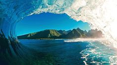TAHITI-- Taken during a morning photo session from inside the tube of a well known Tahiti wave. (Photo: Clark Little)