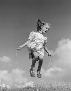 A little girl skipping outdoors. Original Publication: Picture Post - 4848 - Country Holiday - pub. 1949 (Photo by Raymond Kleboe/Getty Images