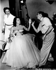 Makeup artist Helen Hunt and still photographer Robert Coburn prepare Rita Hayworth for a shoot promoting Affair in Trinidad