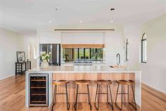 Love to entertain? Be inspired by our client's modern industrial kitchen featuring an accessible wine fridge, gas cooktop and hidden butlers pantry with oodles of space. We are big fans of the Caesarstone Raw Concrete island bench and mirrored splashback.