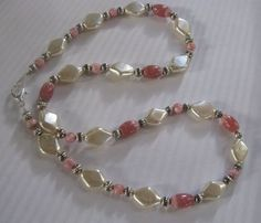 Check out this item in my Etsy shop https://www.etsy.com/listing/34723049/soft-pink-rhodochrosite-pearl-necklace