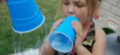 Make GIANT bubbles. Poke a hole in the bottom of a paper cup, or cut off the bottom of a water bottle. Dip. Blow.