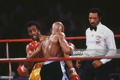American boxer Marvelous Marvin Hagler pictured right in dark shorts in action against fellow American boxer Thomas Hearns in yellow shorts in a. Marvelous Marvin Hagler, American Boxer, Sport Inspiration, Yellow Shorts, Leo, Fitness Motivation, Baseball Cards, Dark, Sports