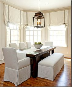 I want this Breakfast area. Love the bench mixed with the chairs. Munger Interiors!!
