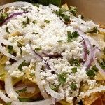 Green Chilaquiles in Roasted Tomatillo Sauce by Pati's Mexican Table