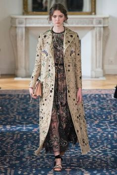 This reminds me of an embroidered raincoat my mother had, which was all Egyptian motifs.