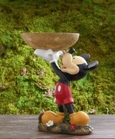 Disney - Mickey Mouse bird bath  How come I do not have one of these.