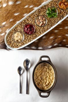 "NEXT RESTAURANT closes ""The Hunt"" with an assortment of garnishes (tart cherry jam, candied pecans, brown-butter sugar, English toffee, mint), which diners are invited to blend into a risotto-like sweet barley pudding. Coins of bison tenderloin are dipped into the resulting mixture."