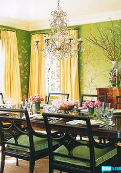 A Divine Dining Room. Emerald green chinoiserie wallpaper and yellow silk. Interior Designer:  Mary McDonald.