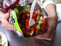 Tostilocos - a bag of chips, cut open and piled high with cucumber, jicama, pickled pork rinds, Japanese peanuts and a lime wedge Mexican Chips, Mexican Snacks, Real Mexican Food, Mexican Street Food, Mexican Food Recipes, Mexican Desserts, Hot Dog Recipes, Pork Recipes, Snack Recipes