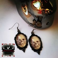 gothic Skull cameo Earrings and necklace set by MetalLiquor on Etsy https://www.etsy.com/listing/469673091/gothic-skull-cameo-earrings-and-necklace