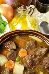"""Moose Stew - 1-2 lb moose round steak cut into 1"""" cubes [remove all fat, bones, silver skin from round steak to reduce wild game taste], 6 cloves garlic, 6 carrots, 1 med turnip, 8 med Russet potatoes, 1 c frozen peas, 1 large onion, 3 c beef broth, 1 c red wine, 1/2 c flour, 3 bay leaves, 3 T olive oil, 1 c water - This recipe gives stove top instructions. Can also use a slow cooker. Add all ingredients, cook low 7 hr or high 3 1/2."""