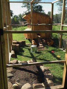 The Seven Sweeties' Amish 5x6' chicken coop and 8x10' run with dust bath, stumps and branches for roosting bars.