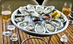 Indulge in a decadent meal that is meant for the hottest days of summer: a tray of oysters on a bed of ice with a glass of champagne (or cava) in hand.  Cost: Prices vary  Contact Info: L Oyster Bar, 1637 Silverlake Blvd., Los Angeles http://www.leoysterbar.com/