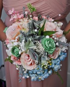 Bridesmaid bouquet Made and photographed by c57studios  The bride chose a pink and mint color pallet for her country themed wedding on her moms farm.  With an old farmhouse as the backdrop!
