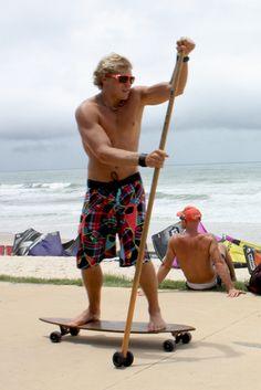 Longboarder land paddle