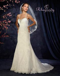 Symphony Bridal #R7311. For more information on these gowns and others that we carry in our store, please call toll free 1-800-344-2672. Or visit www.thewinneroutlet.com