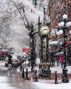 Glorious Gastown Yesterday's blizzard in the heart historic Gastown. The iconic steam clock displays the time on four faces and announces the quarter hours with a whistle chime that plays the Westminster Quarters. Captured yesterday at 2:40pm in Vancouver British Columbia Canada December 5 2016 #Snowcouver