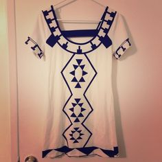 White tribal print dress White, geo tribal print, open-back bodycon dress, says size large on the tag but fits more like a small-medium. One of those DTLA boutique buys with funky sizing. Worn once for my graduation photos and is brand new otherwise! Dresses Mini