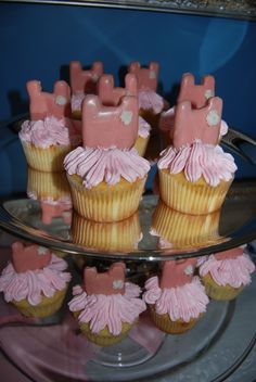 Ballerina tutu cupcakes  The leotard tops are sugar cookies shaped like leotards, coated in pink wilton candy coating with a frosting flower at the top. The tutus are piped frosting (swiss buttercream). After piping the frosting, stick the pointy end of the leotard into the center of the frosted cupcake. Great for ballet party.