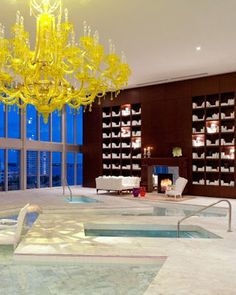 The spa at The Viceroy Miami rocks Tim Burton-like designs, like the mammoth yellow chandelier in the chic water lounge!