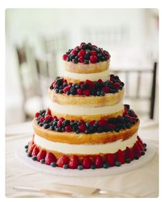 Tiered fresh berry wedding cake. Foster's Premium Catering. Upscale catering for weddings, rehearsal dinners, family reunions and social and fundraising events. York, Maine http://www.fosterspremium.com