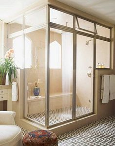 Love this master bath retreat, great shower enclosure, small round fabric covered stool, by Peter Dunham