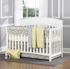 This gray and yellow eden crib bedding is absolutely stunning!! Pair it with our coordinating baby sham and window valances!