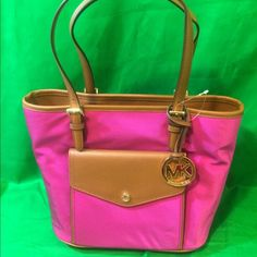 """MICHAEL KORS JET SET ITEM NYLON FUCHSIA PINK MICHAEL KORS JET SET ITEM NYLON FUCHSIA PINK MEDIUM POCKET MULTIFUNCTION TOTE. Nylon with leather trim Double handles with 9"""" drop. Open top Exterior features gold-tone hardware, logo medallion and 1 snap pocket Interior features 1 zip divider, 1 zip pocket, 3 open pockets and 1 cell phone pocket. 13"""" W x 10"""" H x 5"""" D Michael Kors Bags Satchels"""