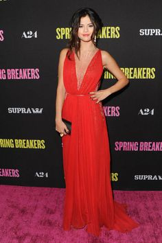 The star attends the Spring Breakers Los Angeles premiere in a chiffon Reem Acra gown.