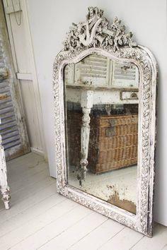 Mirror, wicker trunk under white table