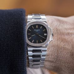 "Why This Watch Matters The Patek Philippe Nautilus is one of the most iconic watches ever produced. We've brought the heat with this white-gold reference 3800/1. You're welcome. The Full Story The Nautilus reference 3700 was notoriously designed by THE Gerald Genta, and released in 1976. It was the first ""sports watch"" that Patek Philippe released, and it has since become a cult classic and favorite among collectors. In 1981, Patek Philippe came out with the reference 3800, a smaller ver..."